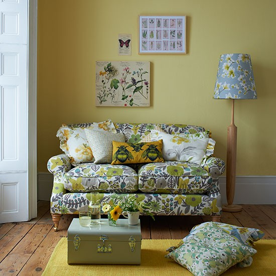 Earthborn yellow paint colour Jemima used in country style living room by Country Home and Interiors magazine