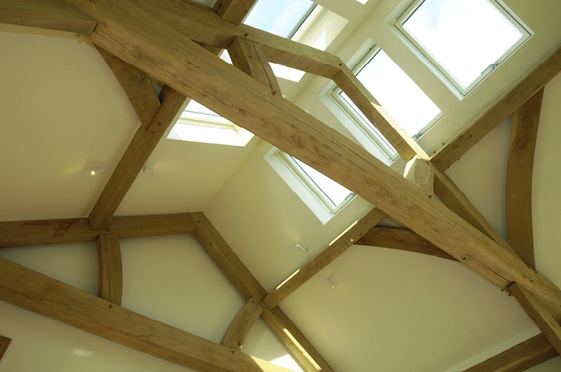 Earthborn Claypaint in Marbles creates a breathable, warm neutral finish in this oak frame property