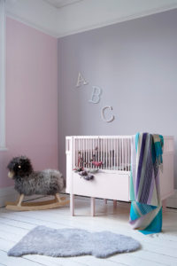 Nursery .ft wall in Eiderdown and Rosie Posie, cot in Cupcake