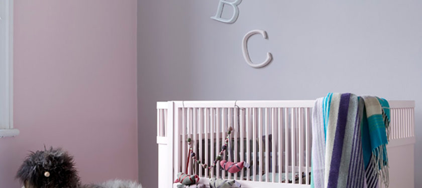Nursery .ft wall in Eiderdown and Rosie Posie, cot in Cupcake