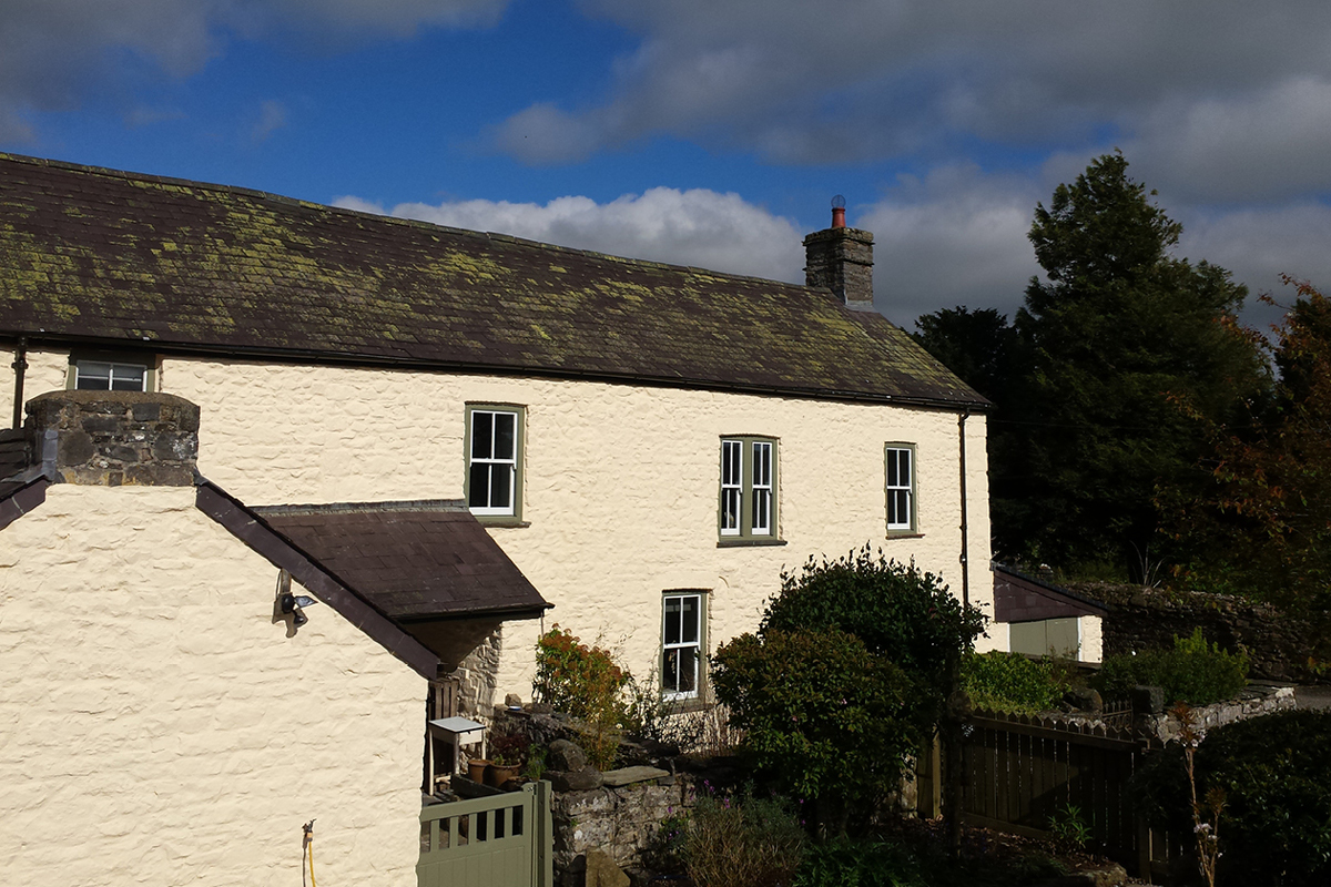 Stone farmhouse painted in Earthborn mineral based Silicate Masonry Paint colour Honeycomb