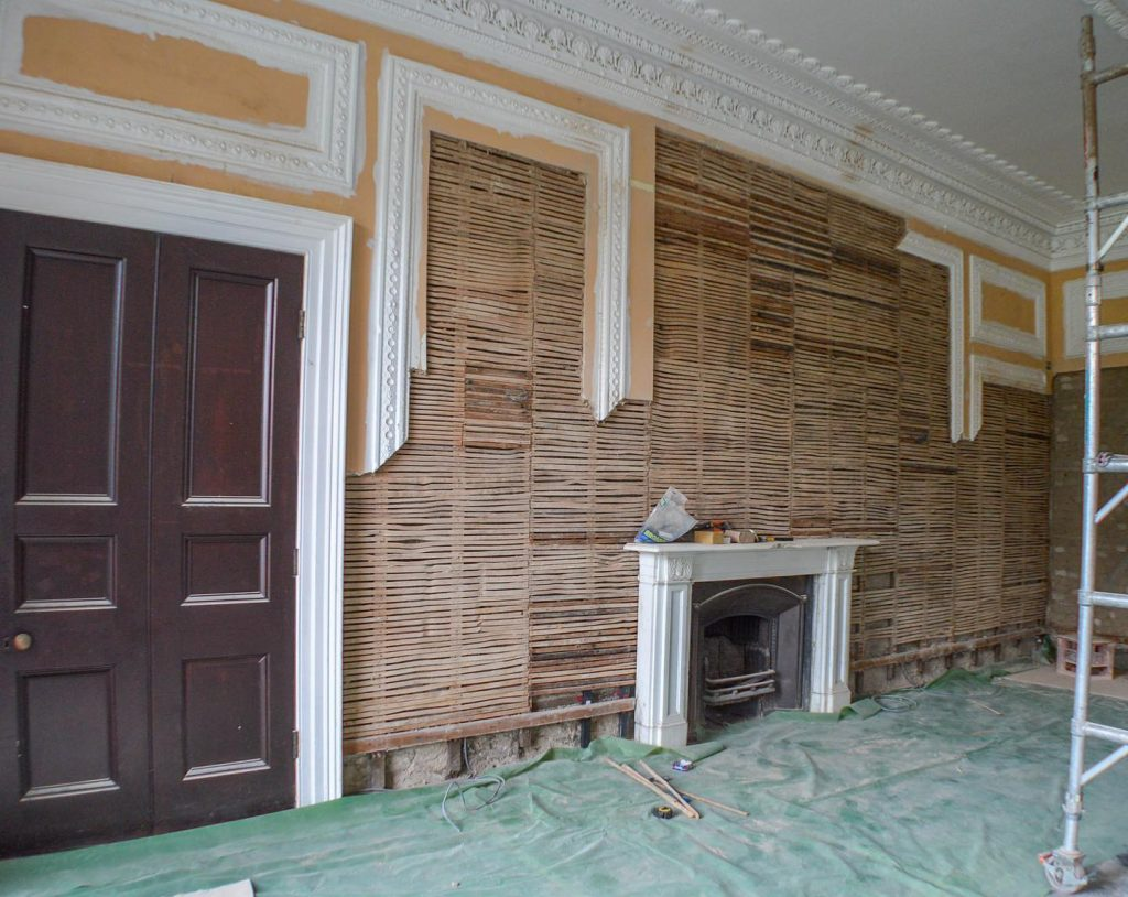 The Club Room at Moreton house was stripped back before lime plastering and painting in Earthborn
