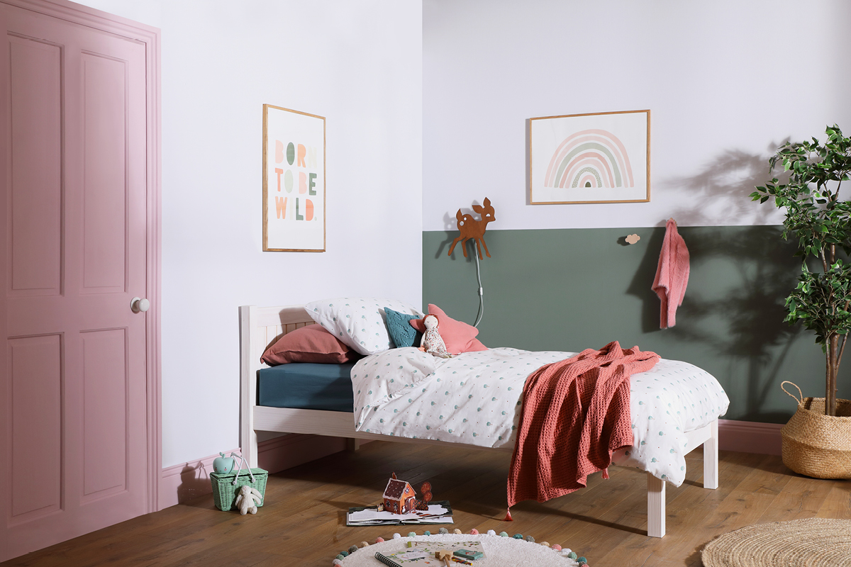 Pops of dusky pink like Rosie Posie and earthy greens like Secret Room shown here, add personality to a child's bedroom for a playful, whimsical touch.