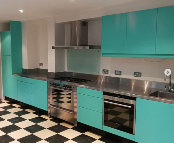 A painted kitchen in Earthborn's Eggshell No.17 using bright turquoise The Lido