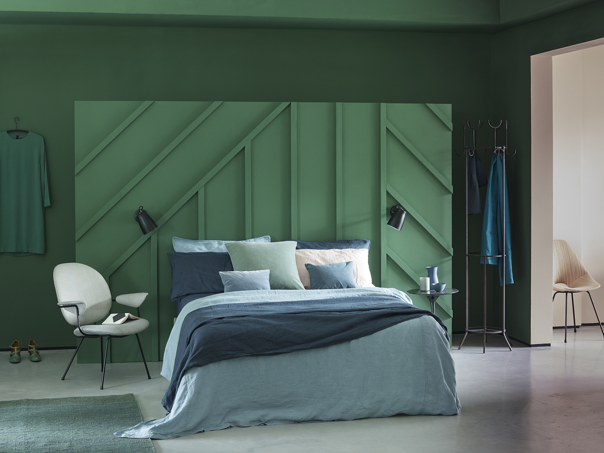 Hobby Wood is a deep forest green that creates a restful bedroom space