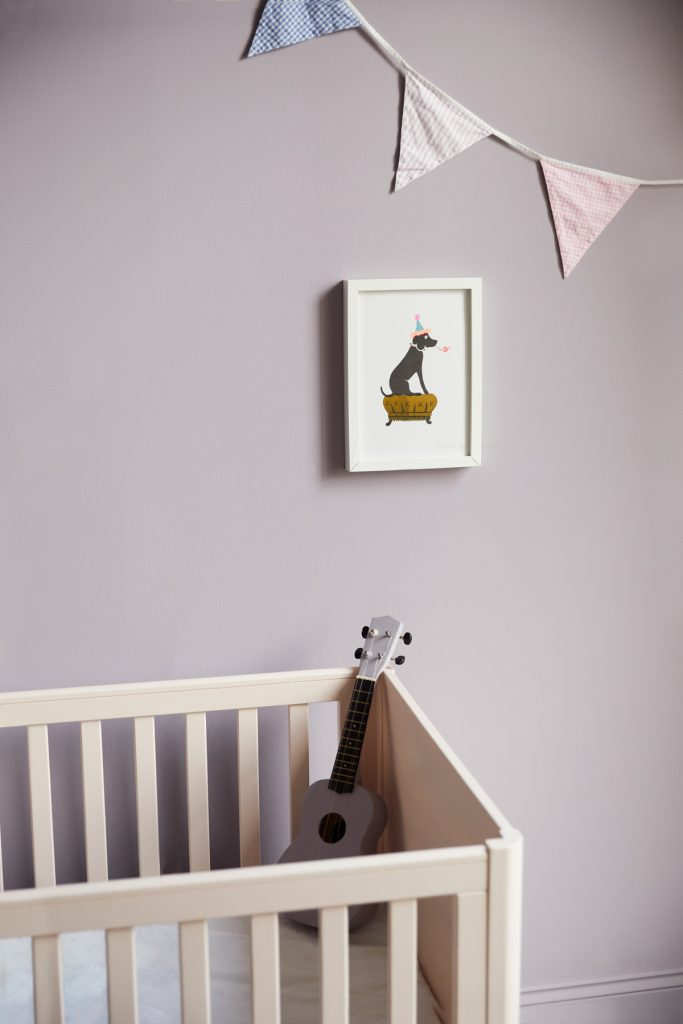 This relaxed nursery features walls in Earthborn Inglenook and cot in Peach Baby