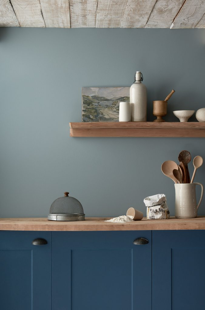 Puddling is a deep blue paint colour that will give kicthen cabinets a contemporary update.
