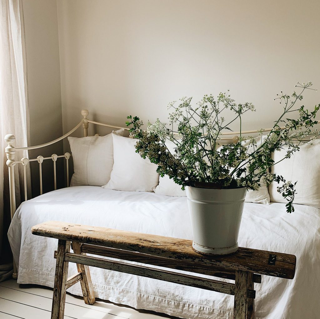 Warm neutral paint colour Tom's Bakery in Claypaint helps to create a calm backdrop to this bedroom
